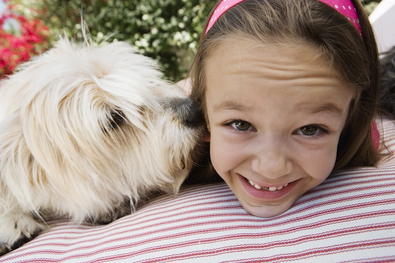 Little girl with her pet dog